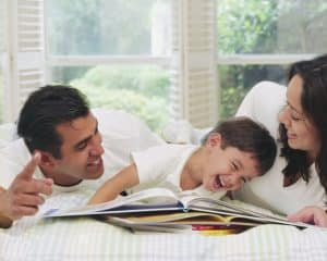 Parents Reading to Laughing Boy
